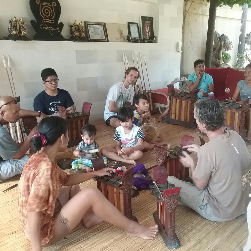 Trevor McPherson with a group playing gamelan instruments