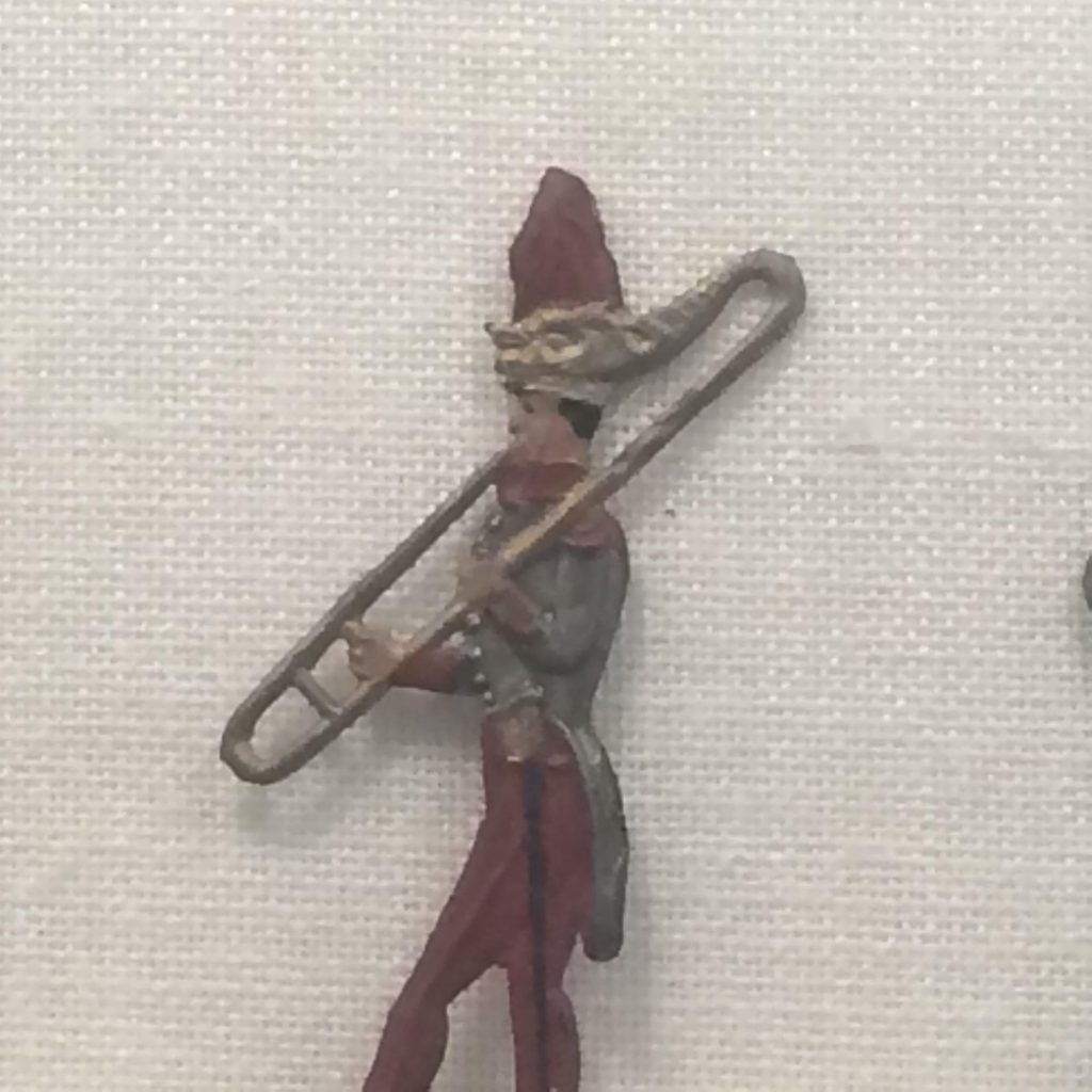 Image of military figurine holding instrument with buccin