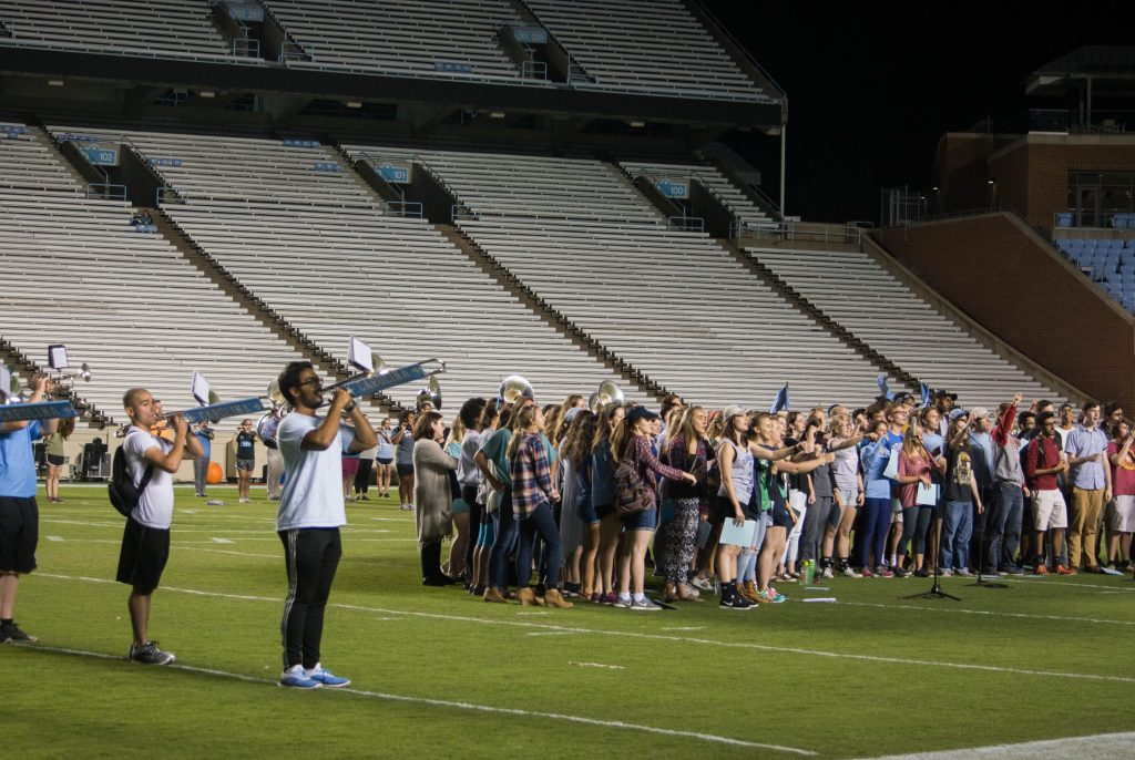 Image of Marching band practicing with Carolina Choir