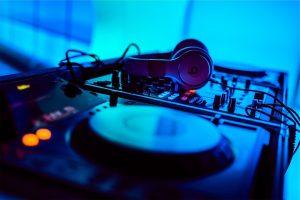 DJ mixing board and headphones