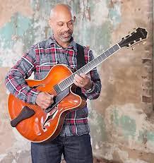 Baron Tymas plays guitar