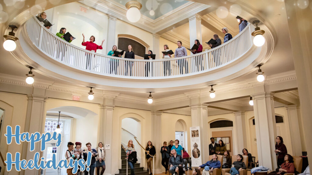Rotunda with Carolina Choir and Chamber Singers carolers performing for an audience of students and community members.