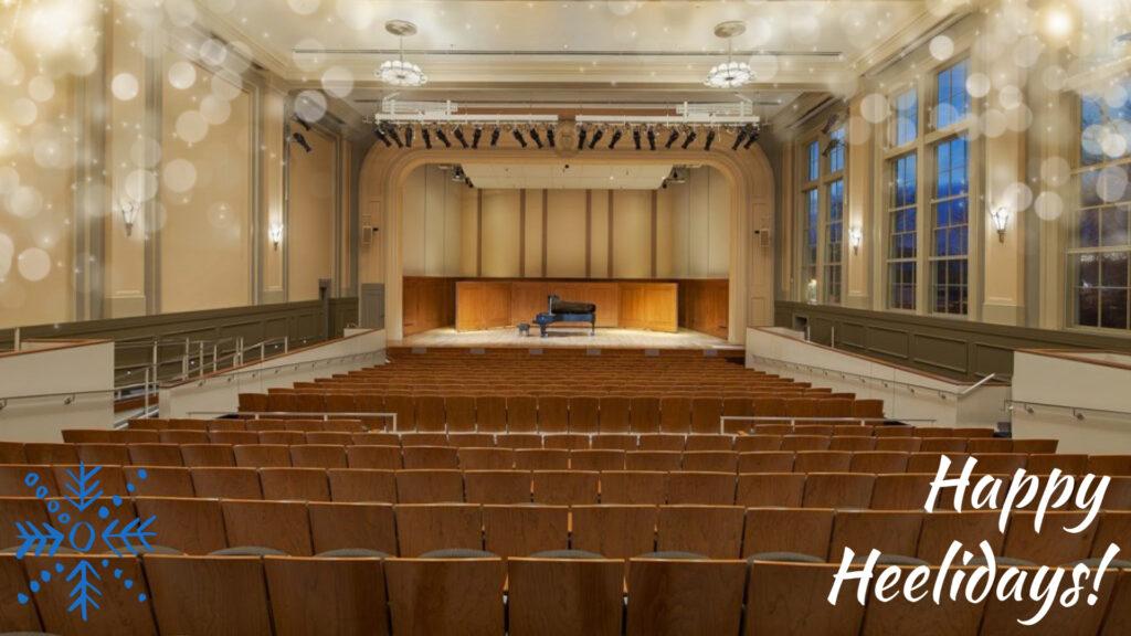 Moeser Auditorium with blue snowflake, fairy lights, and Happy Heelidays! overlaid.