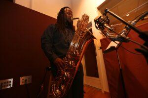 Rahsaan Barber plays saxophone in recording studio for his latest album.