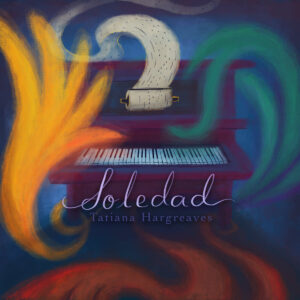 Player piano surrounded by swirling colors, text reads Soledad.