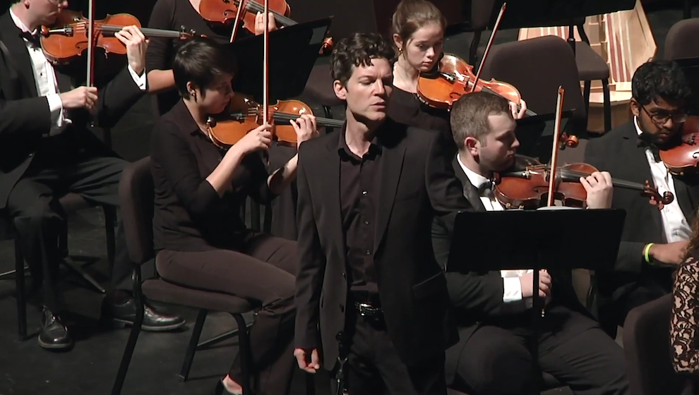 Marc Callahan on Memorial Hall stage with the UNC Symphony Orchestra.
