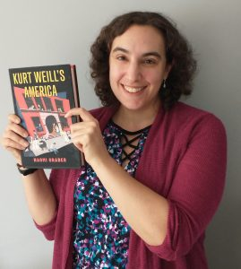 Naomi Graber holds up a copy of her new book Kurt Weill's America.