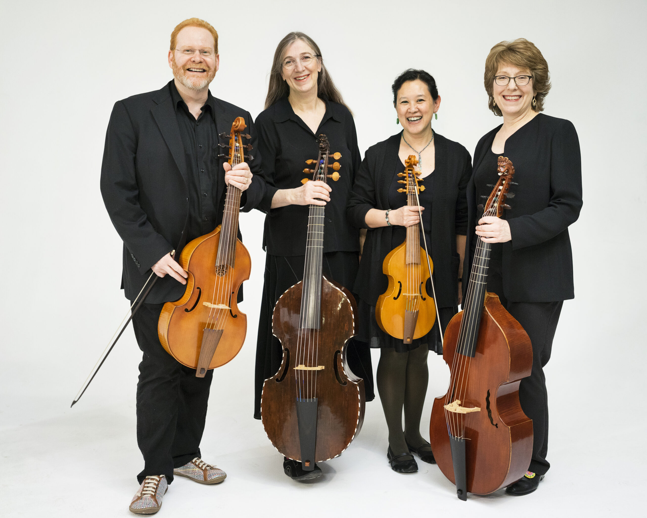 Parthenia musicians pose together with their instruments